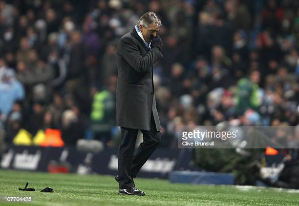 Manchester City manager Roberto Mancini shows his dejection near the end of the match during the Barclays Premier League match between Manchester...