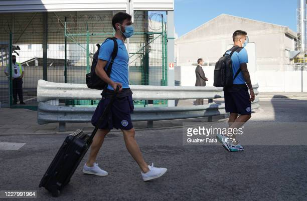 Manchester City midfielder Bernardo Silva and Manchester City defender Joao Cancelo arrive with Manchester City team in Lisbon for the Champions...