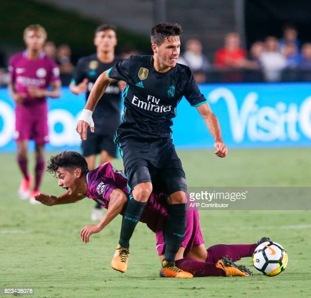 Manchester City midfielder Brahim Diaz left vies the ball against Real Madrid during the second half of the International Champions Cup match on July...