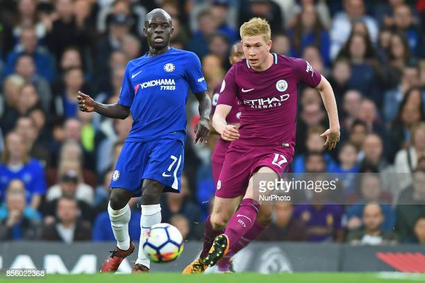 Manchester City midfielder Kevin de Bruyne clears from Chelsea Midfielder Ngolo Kante during the Premier League match between Chelsea and Manchester...