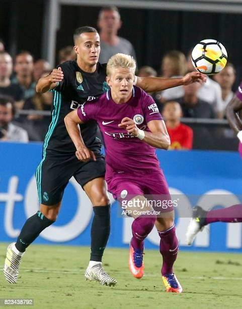 Manchester City midfielder Oleksandr Zinchenko left and Real Madrid forward Lucas Vazquez vie for the ball during the second half of the...