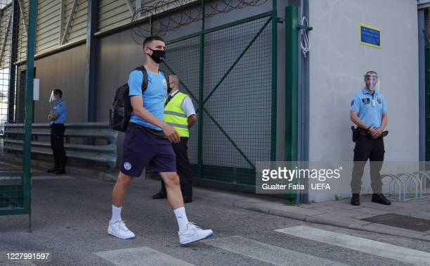Manchester City midfielder Phil Foden arrives with Manchester City team in Lisbon for the Champions League at Humberto Delgado Airport on August 10...
