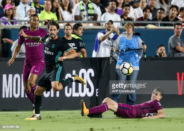 Manchester City midfielder Phil Foden eyes the ball with Isco of Real Madrid during their International Champions Cup football match on July 26 2017...