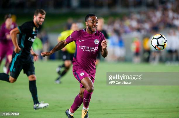 Manchester City midfielder Raheem Sterling right drives the ball against Real Madrid during the second half of the International Champions Cup match...