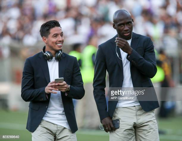 Manchester City midfielder Samir Nasri and midfielder Yaya Toure are seen prior to the International Champions Cup match between Real Madrid and...