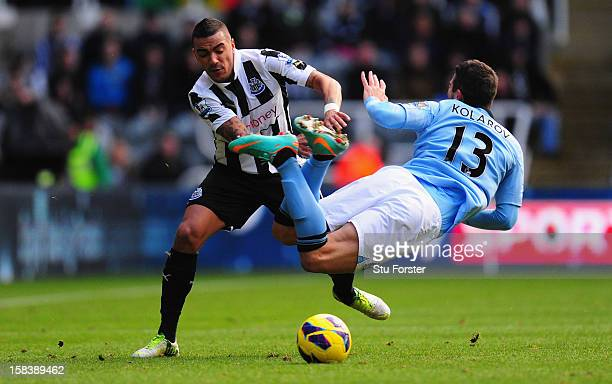 Manchester City player Aleksander Kolarov is challenged by Danny Simpson during the Barclays Premier League match between Newcastle United and...