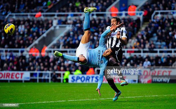 Manchester City player Carlos Tevez attempts an overhead kick watched by Jonas Gutierrez during the Barclays Premier League match between Newcastle...