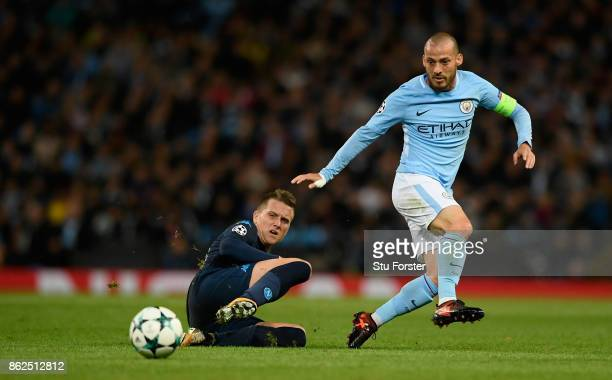 Manchester City player David Silva is challenged by Piotr Zielinski of Napoli during the UEFA Champions League group F match between Manchester City...