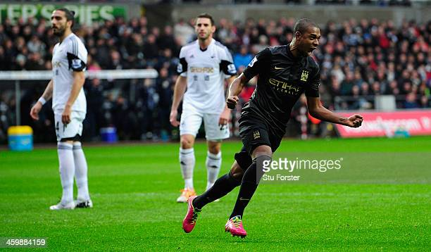 Manchester City player Fernandinho celebrates the opening goal during the Barclays Premier League match between Swansea City and Manchester City at...