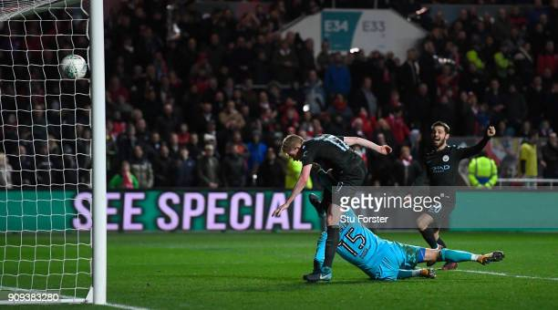 Manchester City player Kevin De Bruyne celebrates with Bernardo Silva after scoring his goal during the Carabao Cup SemiFinal Second Leg match...