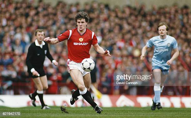 Manchester City player Mark Hughes in action as Neil McNab of Manchester City looks on during a League Division One match at Old Trafford on March 5,...