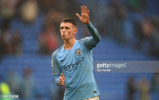 Manchester City player Phil Foden waves to the fans after the Premier League match between Cardiff City and Manchester City at Cardiff City Stadium...
