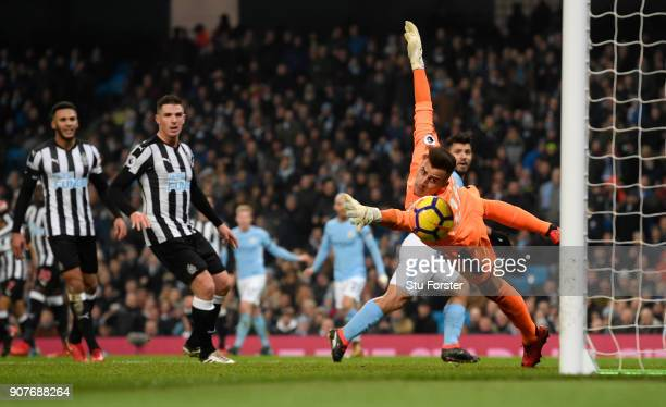 Manchester City player Sergio Aguero scores the opening goal past Karl Darlow during the Premier League match between Manchester City and Newcastle...