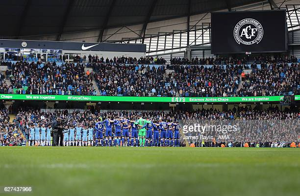 Manchester City players and Chelsea players observe a minutes silence for the victims of the plane crash involving the Brazilian club Chapecoense...
