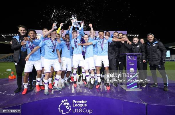 Manchester City players and coaching staff celebrate winning the Premier League Cup after the Under 18's Premier League 2 Cup Final at The Academy...