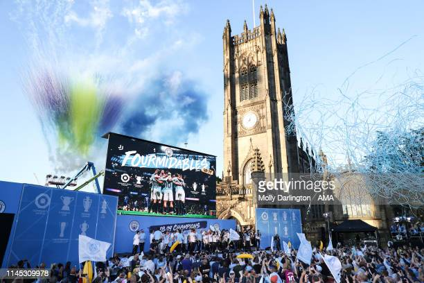 Manchester City players and fans celebrate during the Manchester City trophy parade in Manchester on May 20 2019 in Manchester England
