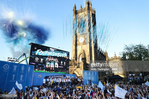 Manchester City players and staff celebrate during the Manchester City trophy parade in Manchester on May 20 2019 in Manchester England