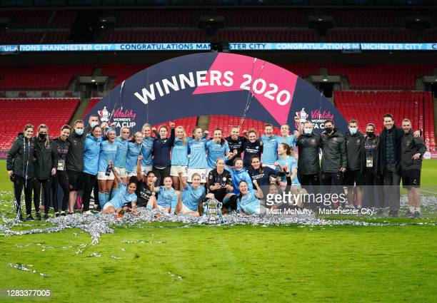 Manchester City players and staff celebrate with the trophy during the Vitality Women's FA Cup Final match between Everton Women and Manchester City...
