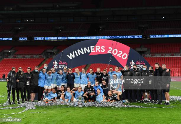 Manchester City players and staff celebrate with the Vitality Women's FA Cup Trophy following their team's victory in the Vitality Women's FA Cup...