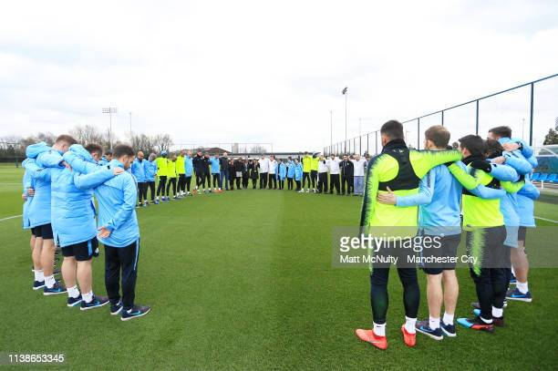 Manchester City players and staff take part in a minute's silence in memory of Bernard Halford during the training session at Manchester City...