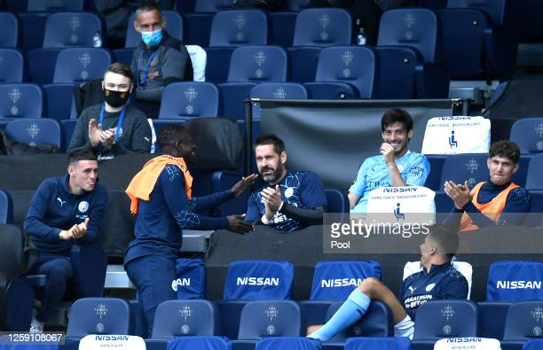 Manchester City players applaud David Silva of Manchester City after he was awarded the man of the match award during the Premier League match...