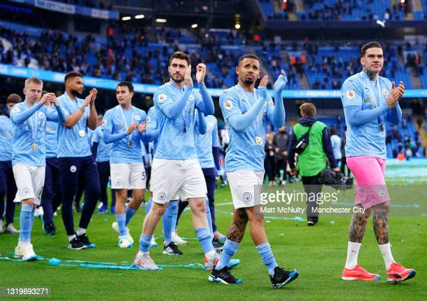 Manchester City players applaud the fans during the Premier League match between Manchester City and Everton at Etihad Stadium on May 23, 2021 in...