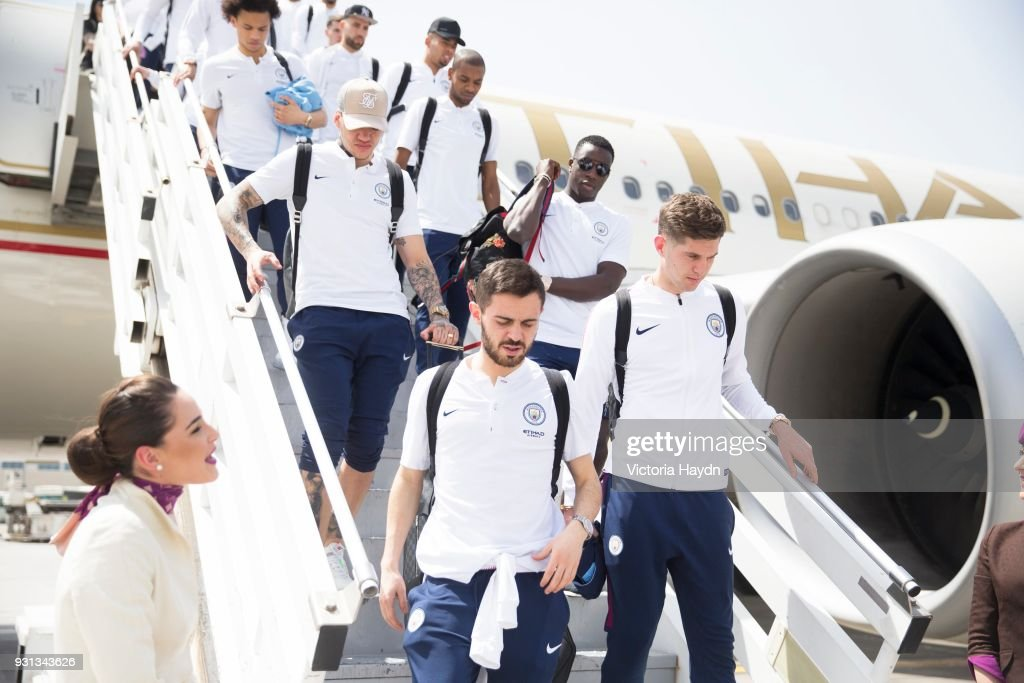Manchester City players arrive at Abu Dhabi International Airport on March 13, 2018 in Abu Dhabi, UAE.