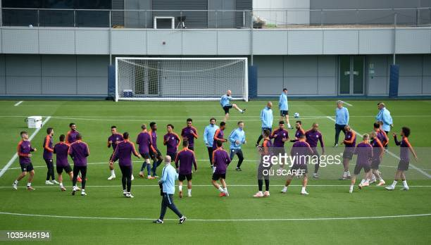 Manchester City players attend a training session at City Football Academy in Manchester north west England on September 18 on the eve of the UEFA...