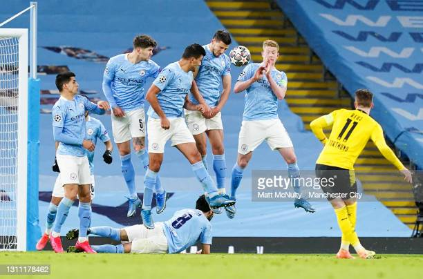 Manchester City players block a free kick taken by Marco Reus of Borussia Dortmund with a wall during the UEFA Champions League Quarter Final match...
