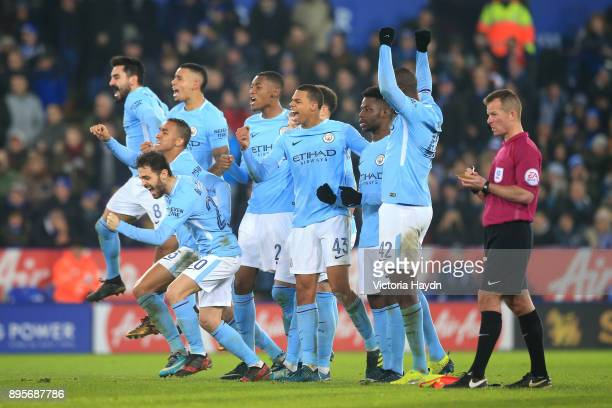 Manchester City players celebrate a succesful penalty in the shoot out during the Carabao Cup QuarterFinal match between Leicester City and...