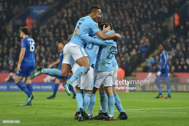 Manchester City players celebrate after Bernado Silva put them 10 up during the Carabao Cup fifth round match between Leicester City and Manchester...