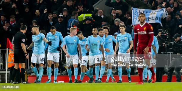 Manchester City players celebrate after Leroy Sane scored his side's equalising goal to make the score 11 during the Premier League match between...