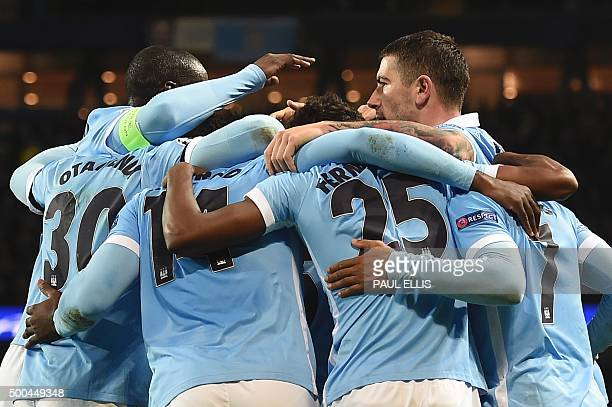 Manchester City players celebrate after Manchester City's English midfielder Raheem Sterling scored his second and City's third goal to take the lead...