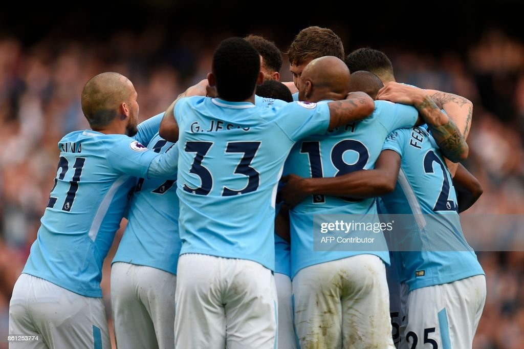 Manchester City players celebrate after Manchester City's German midfielder Leroy Sane scored their sixth goal during the English Premier League football match between Manchester City and Stoke City at the Etihad Stadium in Manchester, north west England, on October 14, 2017. / AFP PHOTO / Oli SCARFF / RESTRICTED TO EDITORIAL USE. No use with unauthorized audio, video, data, fixture lists, club/league logos or 'live' services. Online in-match use limited to 75 images, no video emulation. No use in betting, games or single club/league/player publications. /