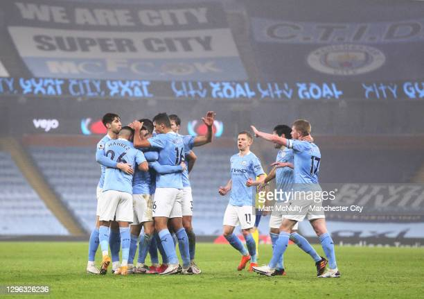 Manchester City players celebrate after Phil Foden scores the first goal during the Premier League match between Manchester City and Brighton & Hove...