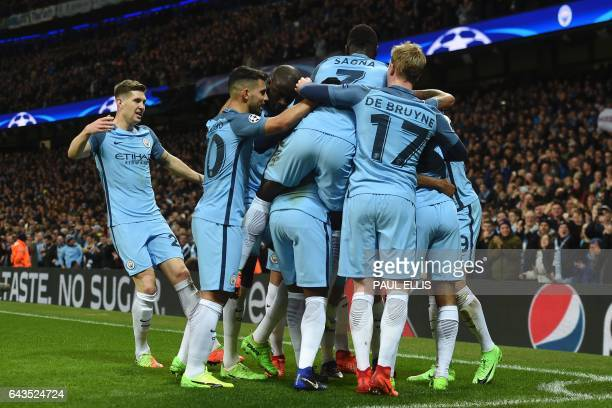 Manchester City players celebrate after Sterling scored their first goal during the UEFA Champions League Round of 16 firstleg football match between...