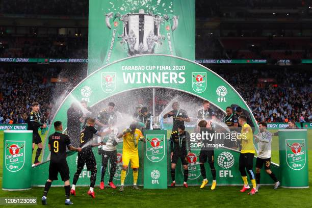 Manchester City players celebrate after the Carabao Cup Final match between Aston Villa and Manchester City at Wembley Stadium