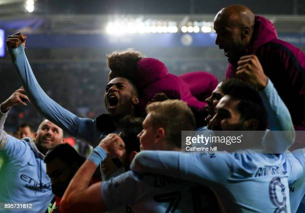 Manchester City players celebrate after the Carabao Cup QuarterFinal match between Leicester City and Manchester City at The King Power Stadium on...