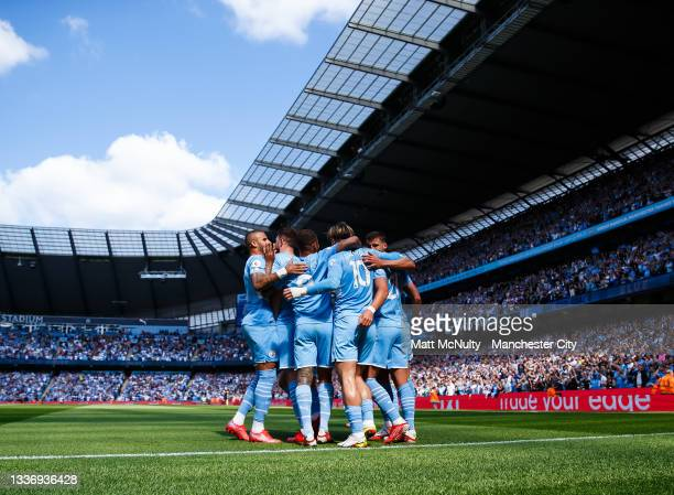 Manchester City players celebrate after the second goal during the Premier League match between Manchester City and Arsenal at Etihad Stadium on...