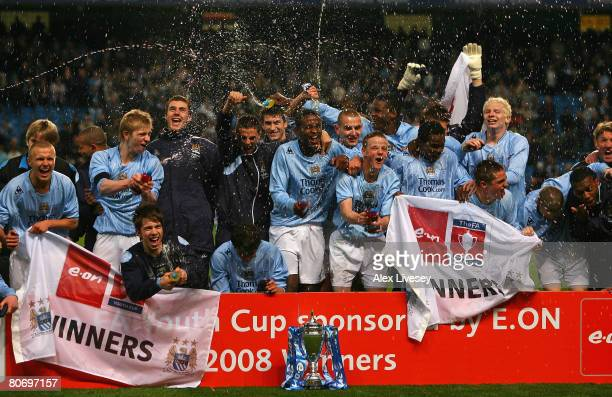 Manchester City players celebrate after victory over Chelsea in the FA Youth Cup Final 2nd Leg match between Manchester City and Chelsea at the City...