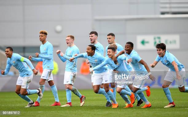 Manchester City players celebrate after winning on a penalty shoot out during the UEFA Youth League QuarterFinal between Manchester City and...