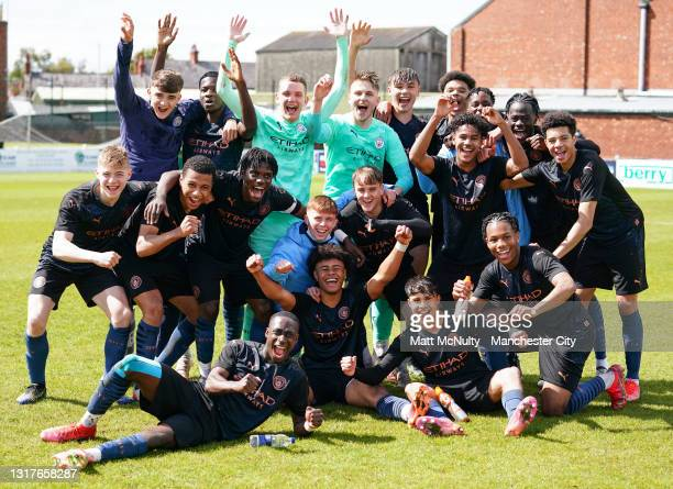 Manchester City players celebrate after winning the Under 18's Premier League North title during the Under 18's Premier League match between Burnley...