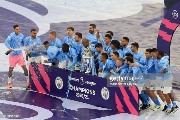 Manchester City players celebrate as Champions with the Premier League trophy following the Premier League match between Manchester City and Everton...