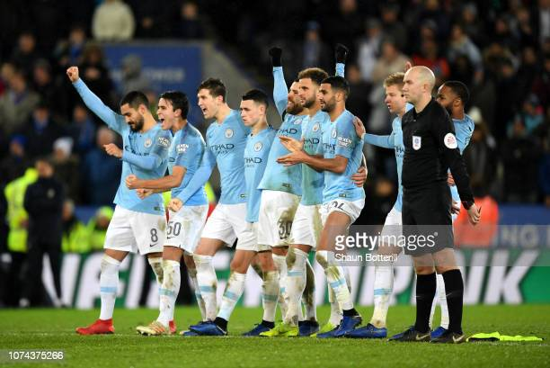 Manchester City players celebrate as they win the penalty shoot out during the Carabao Cup Quarter Final match between Leicester City and Manchester...