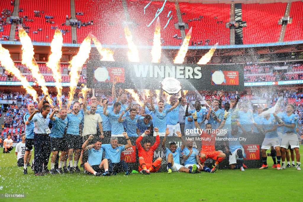 Manchester City players celebrate as Vincent Kompany of Manchester City lifts the FA Community Shield following their sides victory in the FA Community Shield between Manchester City and Chelsea at Wembley Stadium on August 5, 2018 in London, England.