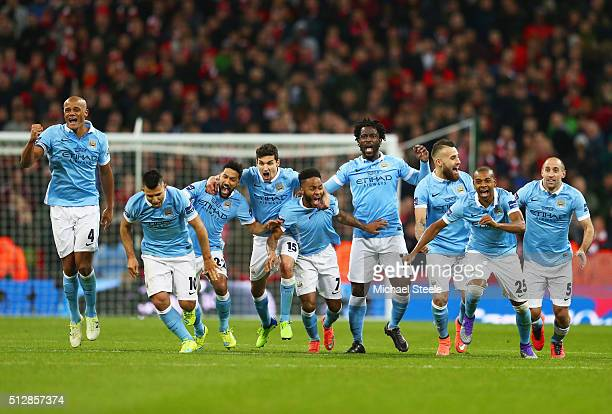 Manchester City players celebrate as Yaya Toure scores the winning penalty to win the shoot out during the Capital One Cup Final match between...
