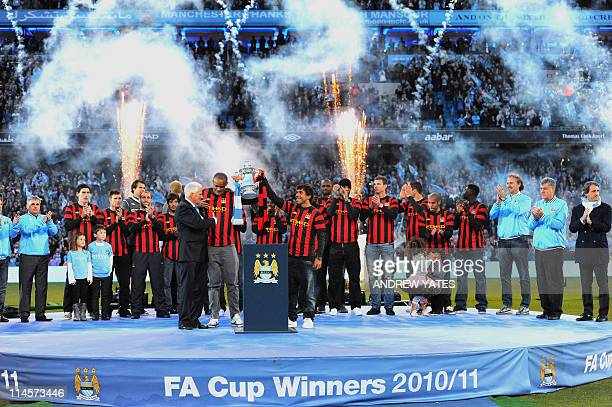 Manchester City players celebrate at the end of the season after with the FA Cup at The City of Manchester football stadium Manchester northwest...
