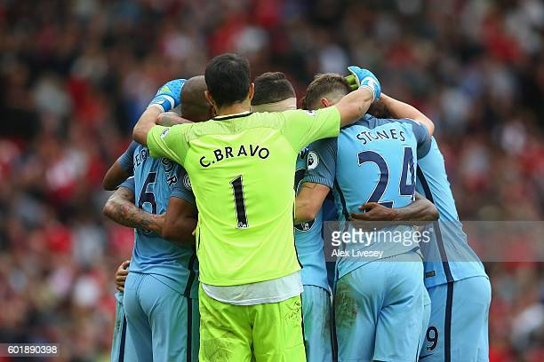 Manchester City players celebrate during the Premier League match between Manchester United and Manchester City at Old Trafford on September 10 2016...
