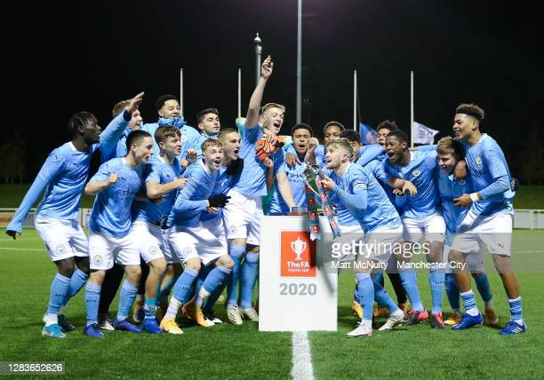 Manchester City players celebrate lifting the trophy during the FA Youth Cup Final match between Manchester City and Chelsea at St Georges Park on...