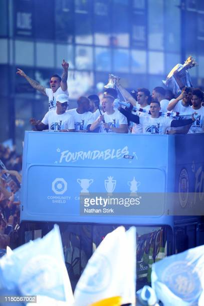 Manchester City players celebrate on a parade bus during the Manchester City Teams Celebration Parade on May 20 2019 in Manchester England